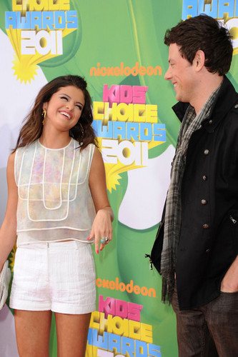 Cory Monteith wallpaper probably with bare legs and a sign called Cory & Selena:)