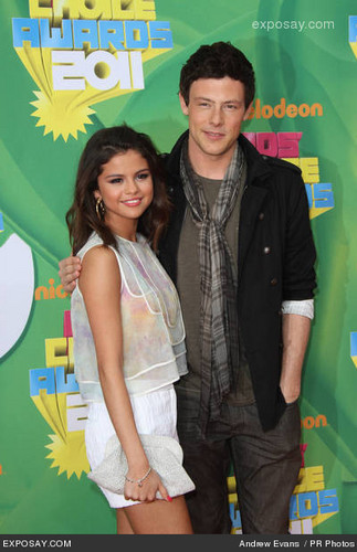 Cory Monteith wallpaper containing a sign and anime titled Cory & Selena:)