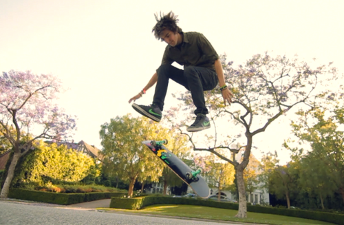 Dave riding a skatebord for his 'Who Says' vid