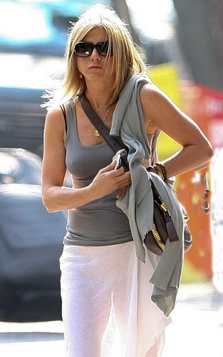 Jennifer Anniston wearing a see through white skirt, upindo in downtown New York City (June 21).