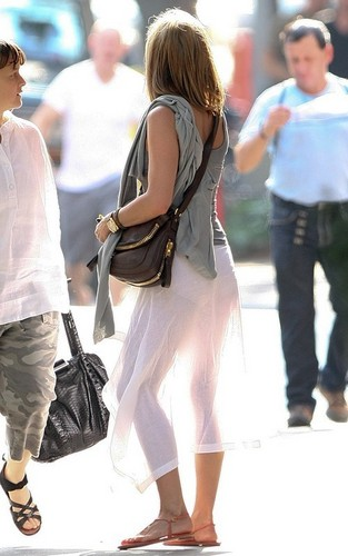 Jennifer Anniston wearing a see through white 치마 in downtown New York City (June 21).