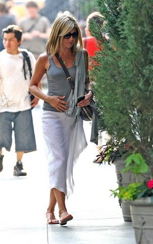 Jennifer Anniston wearing a see through white スカート in downtown New York City (June 21).