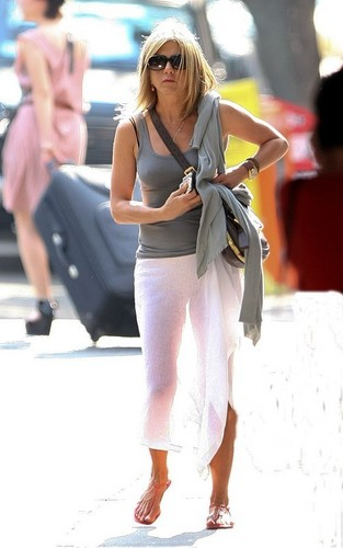 Jennifer Anniston wearing a see through white स्कर्ट in downtown New York City (June 21).