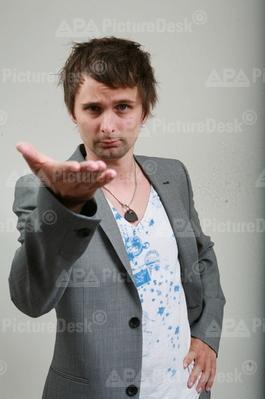 Matthew Bellamy wolpeyper probably with a well dressed person and a portrait entitled Matt *-*