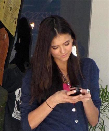 Nina on her phone.