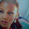 Zoë Saldaña as Uhura photo with a portrait titled Uhura
