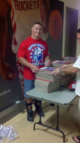 Cena sighing autographs at Houston, TX
