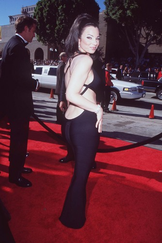 Fran Drescher wolpeyper possibly with bare legs, hosiery, and a hip boot titled Fran Drescher