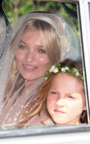 Kate Moss and Jamie Hince on their wedding hari (July 1)
