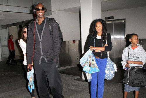 Khloe Kardashian And Lamar Odom Arriving On A Flight At LAX - khloe-kardashian Photo