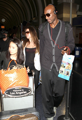 Khloe Kardashian wallpaper entitled Khloe Kardashian And Lamar Odom Arriving On A Flight At LAX