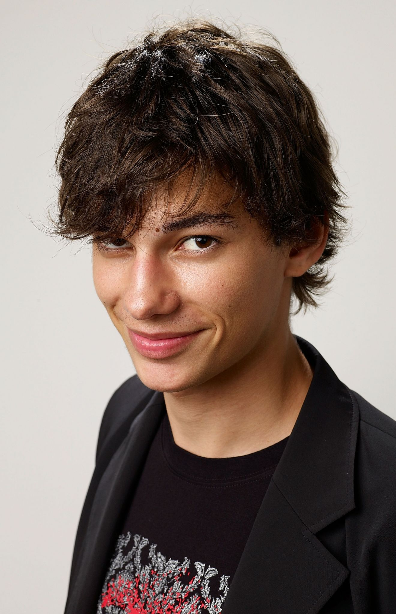 Devon Bostick - 2017 Regular Brown hair & chignon hair style. Current length:  short hair