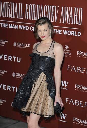 milla jovovich wallpaper probably with a koktil, koktail dress, a gathered skirt, and a dress called magnificent milla