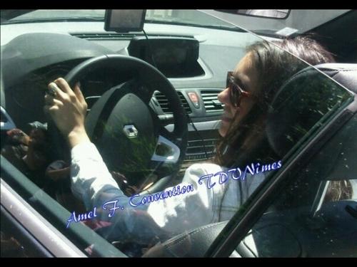 nina in a car