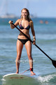 AnnaSophia paddle surfing in Hawaii, Jul 4