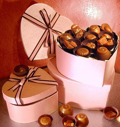 Delicious Recipes wallpaper possibly with a bonbon, a peanut, and a peanut entitled Chocolates