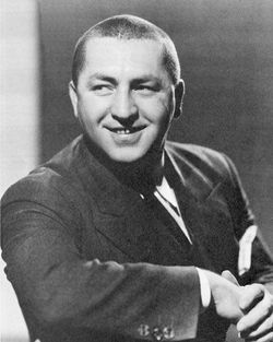 Three Stooges wallpaper possibly with a business suit called Curly Howard