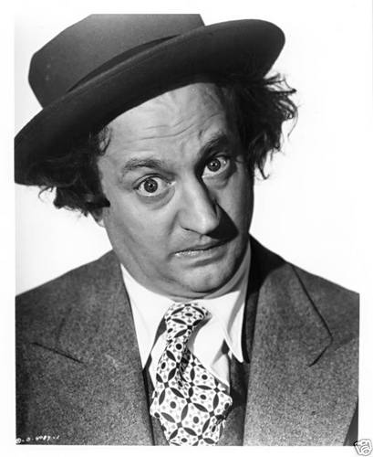 Three Stooges wallpaper with a business suit called Larry Fine