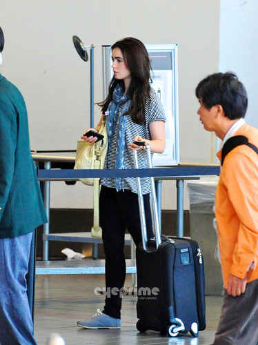Lily Collins wallpaper possibly containing a hip boot called Lily Collins departs LAX, July 4