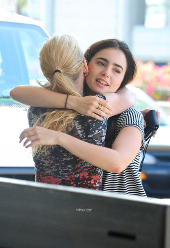 Lily Collins departs LAX, July 4