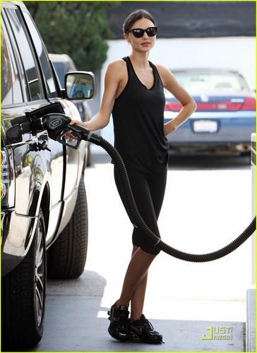 Miranda Kerr stops at a gas station to fill her car up with a full tank of gas on Sunday (July 3)