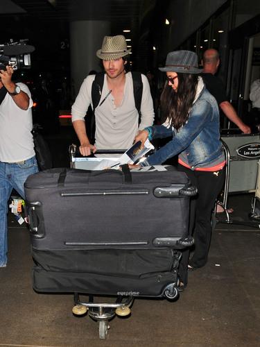 Nina Dobrev & Ian Somerhalder land at LAX, Jul 5