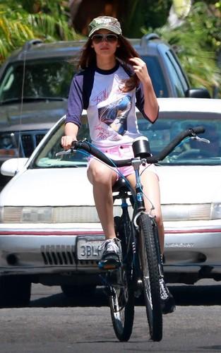 Victoria Justice riding her bike with her boyfriend, actor Ryan Rottman (July 1).
