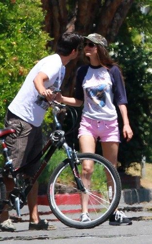 Victoria Justice riding her bike with her boyfriend, actor Ryan Rottman (July 1).