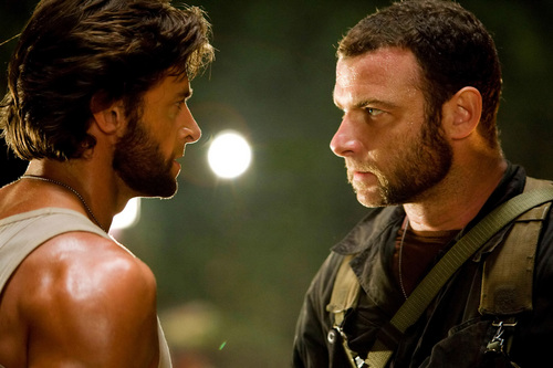 Hugh Jackman as Wolverine wolpeyper probably with a konsiyerto and a green birete titled Wolverine & Sabertooth