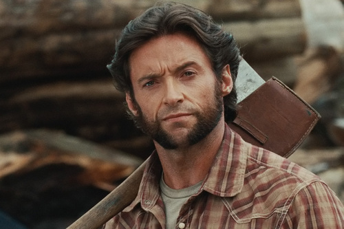 Hugh Jackman as Wolverine wolpeyper with a cleaver titled Wolverine