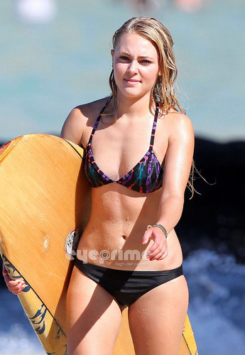 AnnaSophia Robb in a Bikini surfing in Waikiki, July 4