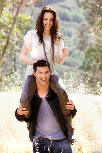 Taylor Lautner پیپر وال probably containing an outerwear, a hip boot, and a well dressed person called ♥