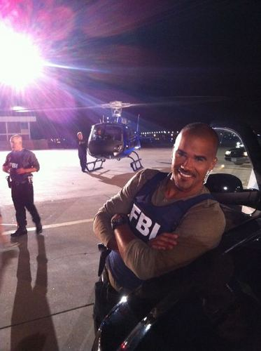 "7x01 ""It Takes a Village"" Behing the Scenes Shemar Moore smiling"