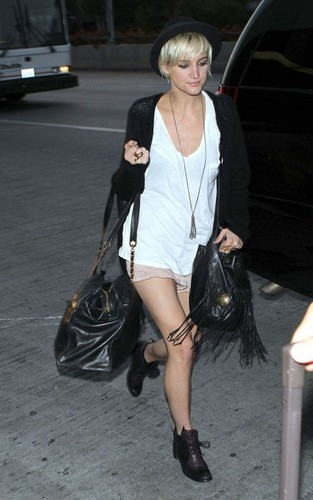 Ashlee Simpson arriving for a flight at LAX airport in Los Angeles (July 6).