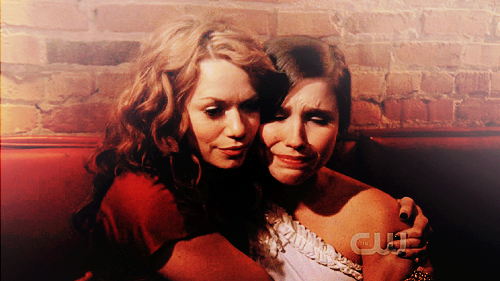One Tree Hill wallpaper probably containing a sign and a portrait called Brooke and Haley