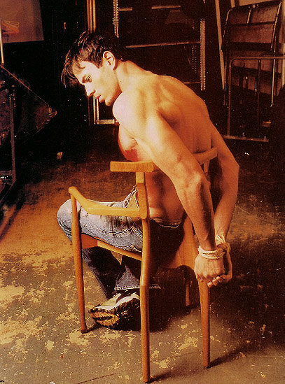 Sexy man tied to chair