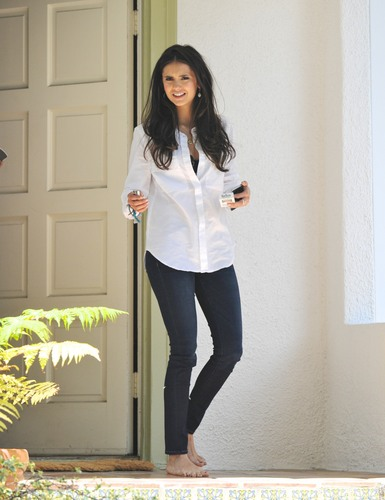 Nina Dobrev wallpaper possibly containing a well dressed person, an outerwear, and long trousers entitled Nina - On the set of a photoshoot in West Hollywood - July 07, 2011