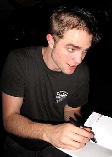 Robert with new hair cat in cosmopolis