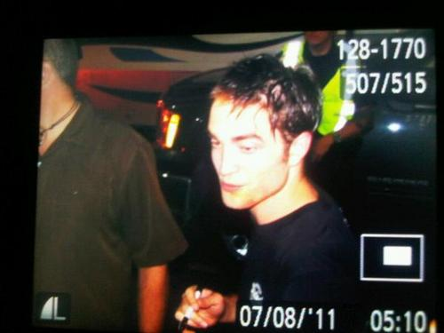 Robert with new hair cat in cosmopolis