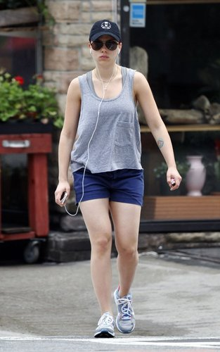 Scarlett Johansson showing off her red hair and tattoos in NYC (July 6).
