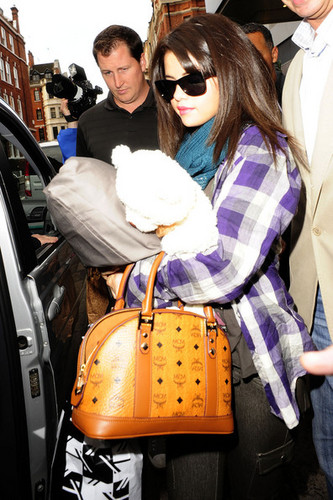 Selena leaves her London hotel with an MCM bag in hand
