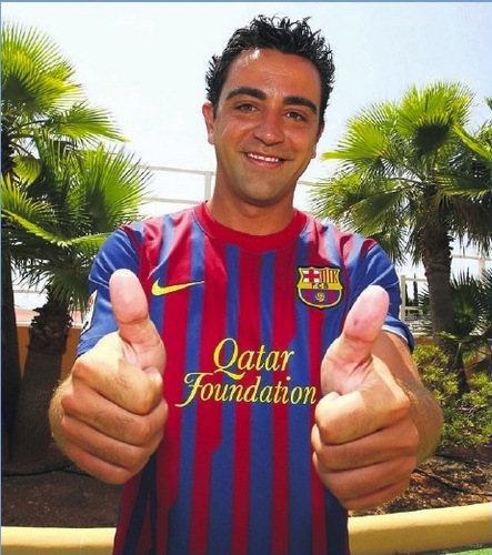 Xavi wearing the 2011-12 home jersey