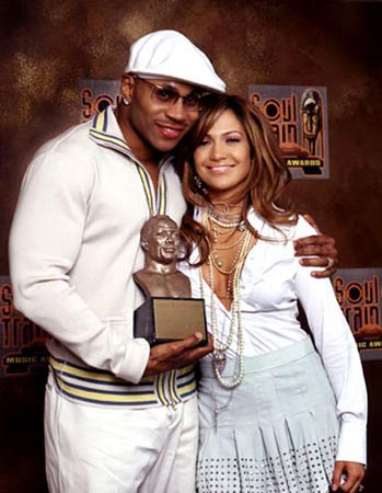 jennifer lopez wallpaper probably with a sign called soul train awards 2003 LL Cool J & JLo