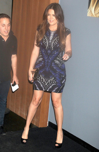 Khloe Kardashian wallpaper possibly with bare legs, tights, and a cocktail dress entitled Khloe Kardashian Hosts The HPNOTIQ Harmonie Launch Party