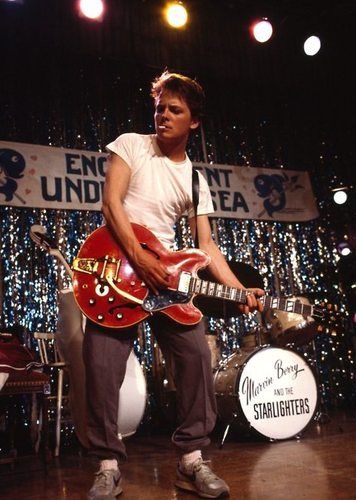 Michael J Fox wallpaper containing a drummer, a concert, and a guitarist titled Marty