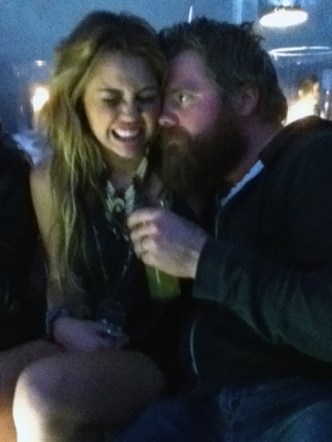 Ryan Dunn wallpaper probably containing a business suit, a well dressed person, and a portrait titled Ryan Dunn with Miley Cyrus