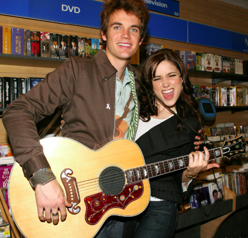 Tyler Hilton wolpeyper probably containing a guitarist and an acoustic gitara called TylerHilton