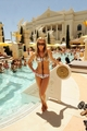 Ashley Tisdale Lounges Poolside at Venus Pool Club