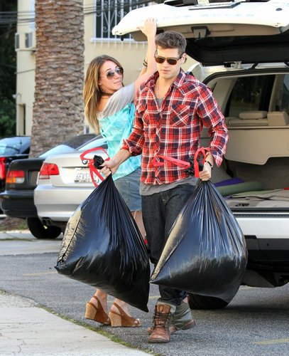 Haylie - In shorts donating clothes to Goodwill in Toluca Lake - March 31, 2010