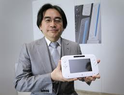 Iwata and the Wii U controller.
